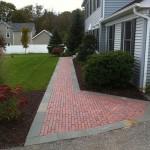 Custom brick walkway leading up to front door