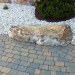patio edge built around large boulder