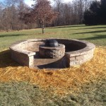 large circular fire pit with sitting walls