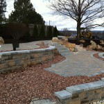 large stone garden with walkway and retaining walls