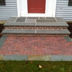 Closeup of custom brick steps installed