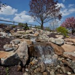 Natural stone installed integrated into a waterfall system