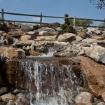 Closeup of waterfall cascading into pond