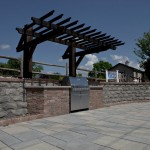 outdoor kitchen and patio with custom roof